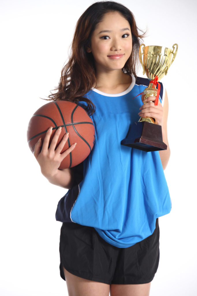 A lady won an award from participating extracurricular activities at school.