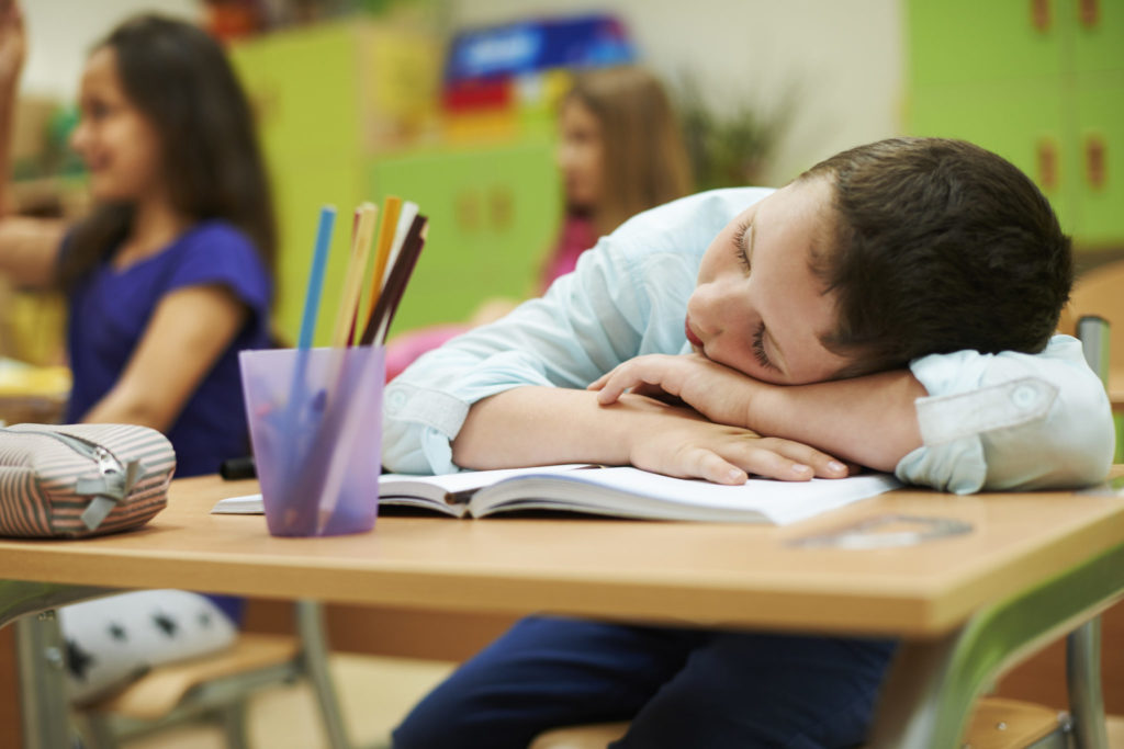 Kid fall asleep during his test preparation in class